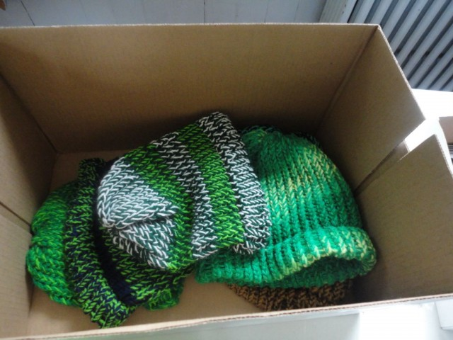A box of hand-knitted hats donated to CUMC of Massapequa by Lynn Rees. Photo Credits: Alaysia Ray