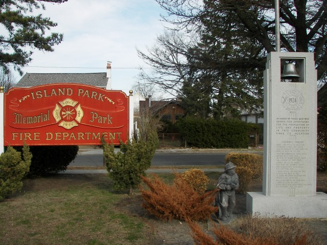 A monument stands next to a sign for the Island Park Fire Department. Photo Credit: Camilla Arellano
