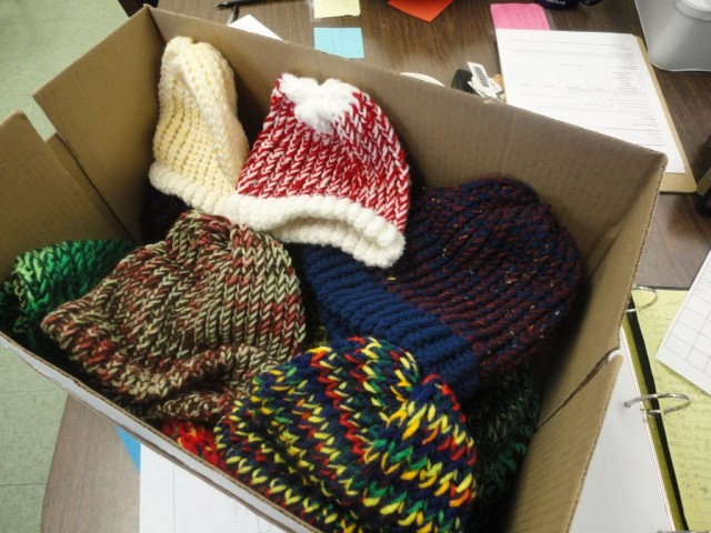Another box of hand-knitted hats that were donated. Photo Credits: Alaysia Ray