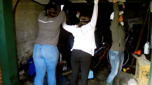 Members of the Hofstra Equestrian Team gutting out the garage of a home after Sandy. Photo Credit: Katie Coe