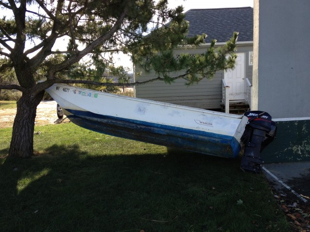 After Sandy, Ralph Miranda, 22, returned to find one of the boats proped up in a tree from the storm. Photo Credit: Ralph Miranda
