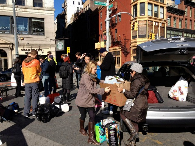 SandyBaggers loading up cars with donations for the Rockaways. Photo Credit: SandyBaggers