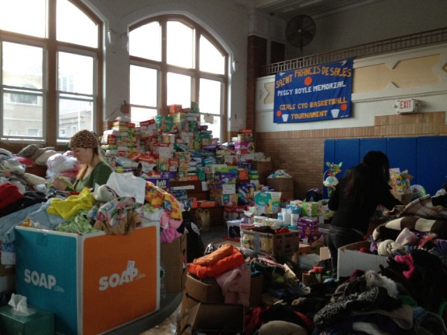 Piles of donations collected from the Union Square drive. Photo Credit: SandyBaggers