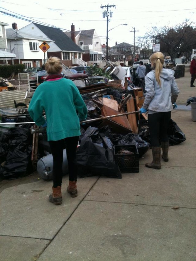 Opperman sifts through debris in Rockaway Beach post-Sandy. Photo Credit: Mary-Anastasia Opperman and Jason Rivera